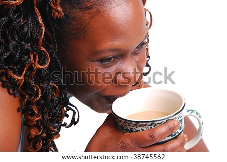 African American woman drinking coffee, isolated on white. - stock photo