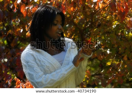 African-American woman emotionally aroused about the colors on the leaf - stock photo