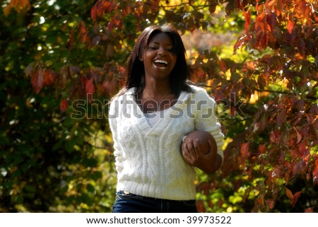 African-American woman enjoys sports outdoors - stock photo