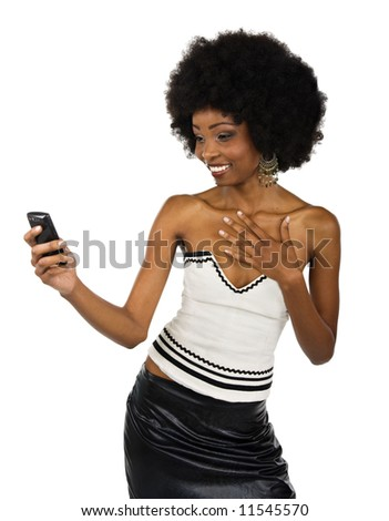 African American woman formal dressed looking at the cell phone - stock photo