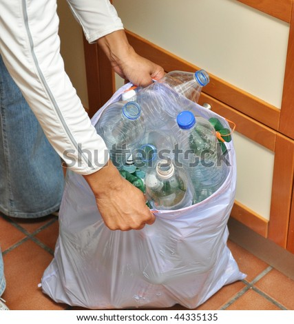 African American woman Hands grabbing recycling trash bag - stock photo