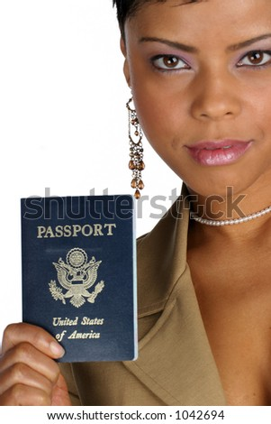 African American woman hands you her passport - stock photo