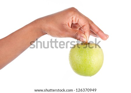 African American woman holding a fresh apple in her hand,isolated on white background