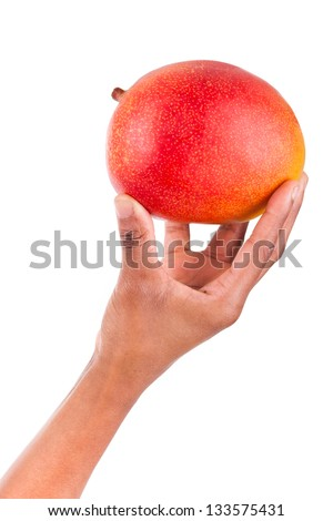 African American woman holding a fresh Mango in her hand,isolated on white background - stock photo