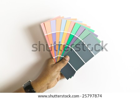 African American woman holding a selection of paint swatches