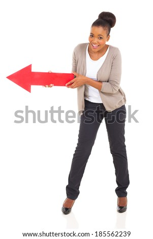african american woman holding red arrow pointing to left - stock photo