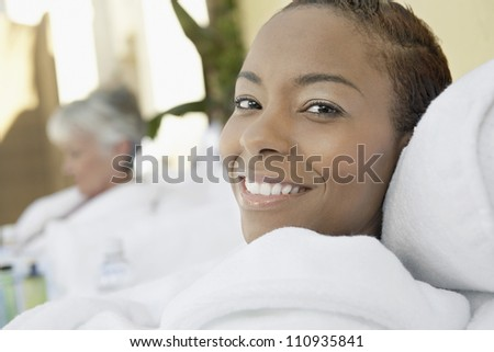 African American woman in bathrobe resting