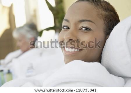 African American woman in bathrobe resting - stock photo