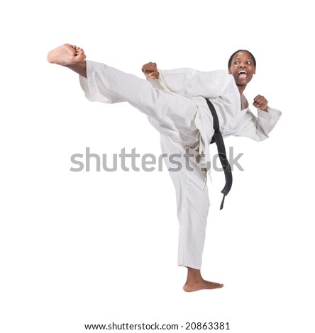 african american woman in karate suit - stock photo