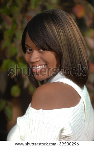 African-American woman looking an smiling over her shoulder - stock photo