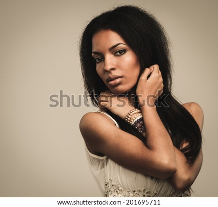 African-american woman on isolated background  - stock photo
