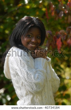 African-American woman outside on a cool fall day - stock photo