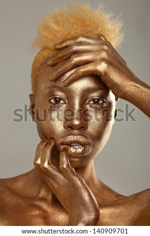 African American Woman Painted With Gold - stock photo