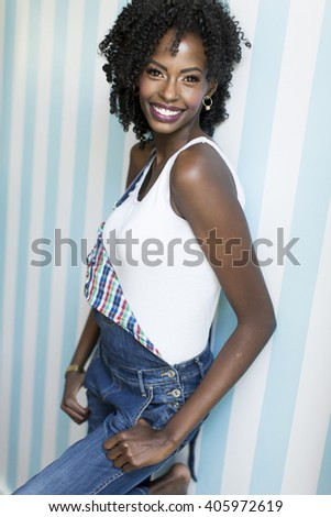 African american woman posing by the wall - stock photo