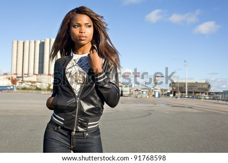 African American woman posing in harbor - stock photo