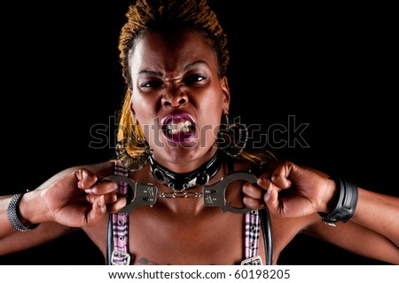 African american woman shouting with handcuffs in hand.