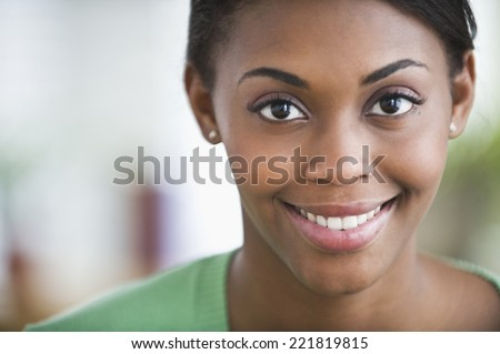 African American woman smiling - stock photo