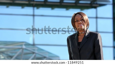 African american woman standing in an office environment.