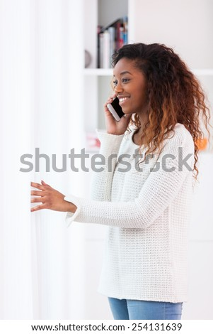 African American woman talking on a mobile phone - Black people - stock photo