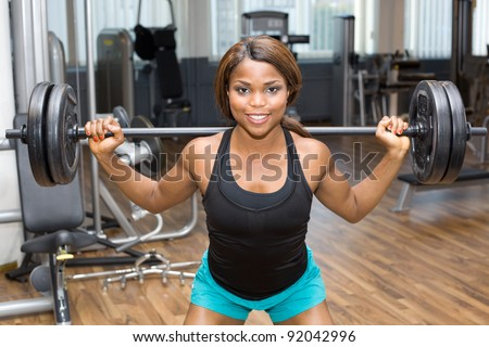 African American woman training in gym