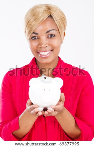 african american woman with piggy bank - stock photo