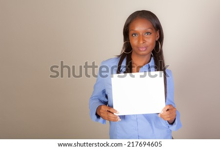 African American woman with some American Indian heritage holding a sign with room for copy space - stock photo