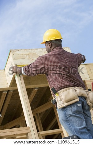 African american worker building wooden structure
