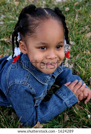 African American 3-Year-Old Girl on Grass