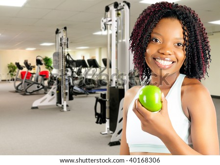African American Young Woman Enjoying A Healthy Snack At The Gym - stock photo