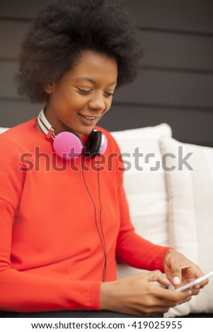 African american young woman with mobile phone