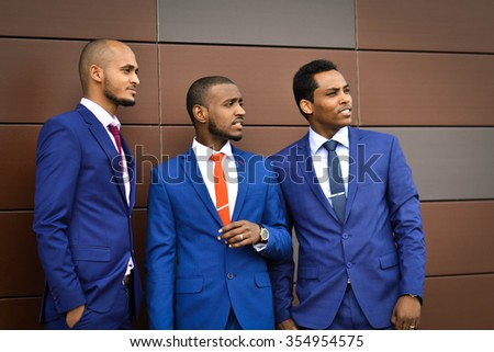 African,azerbaijani important,happy people,discussing,stipulate a very important trade deal,business project in a Financial District,business meeting,business people,business man,business team,leader - stock photo