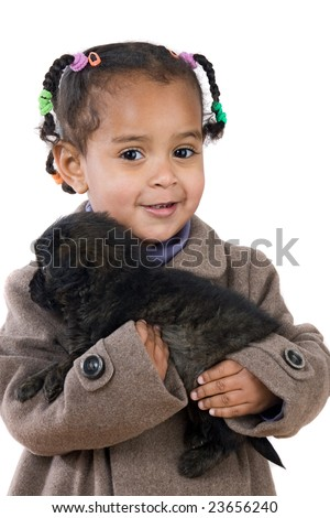 African baby holding a puppy on her arms isolated over white - stock photo