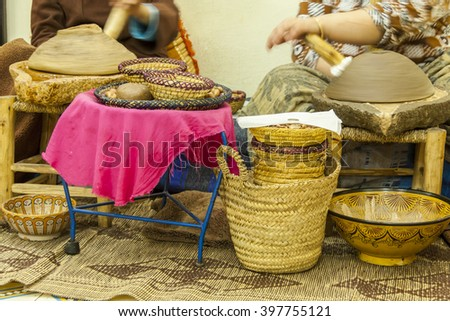 African basket weavers creating and selling straw baskets
