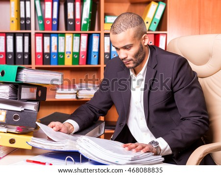 african bookkeeper working with papers in the office