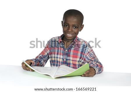 African Boy with Text Book, Studio Shot - stock photo