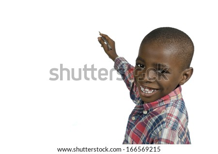 African Boy writing with pencil, Free copy space, Studio Shot - stock photo