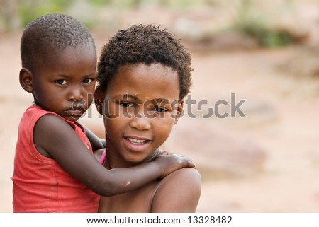 African brother and sister deprived children in a village near Kalahari Desert - stock photo