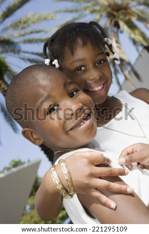 African brother and sister hugging - stock photo
