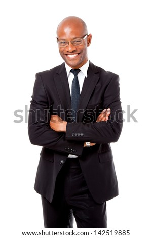 African business man folding his arms shot on an isolated background
