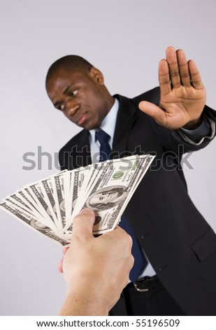 African business man refusing many dollar banknotes - stock photo