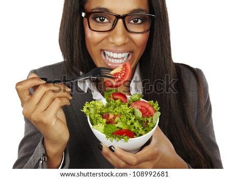 african business woman eating salad and smiling isolated
