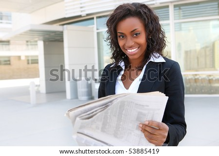 African  business woman reading paper outside office - stock photo