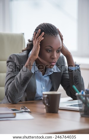 African Business woman working using laptop computer in office - stock photo