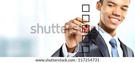 african businessman choosing one of three options - stock photo