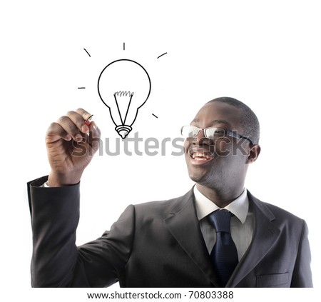 African businessman drawing a light bulb - stock photo