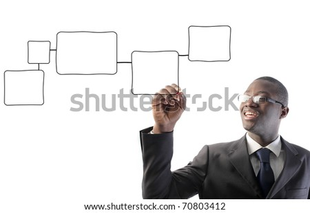 African businessman drawing graphics - stock photo