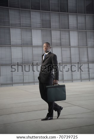 African businessman in front of an office building - stock photo