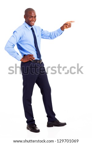 african businessman pointing at empty copyspace - stock photo