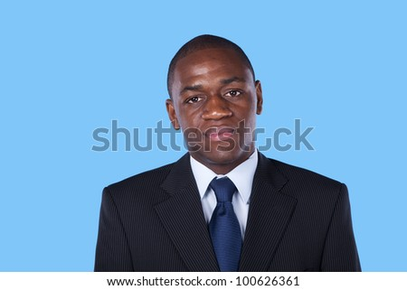African businessman portrait (blue background) - stock photo