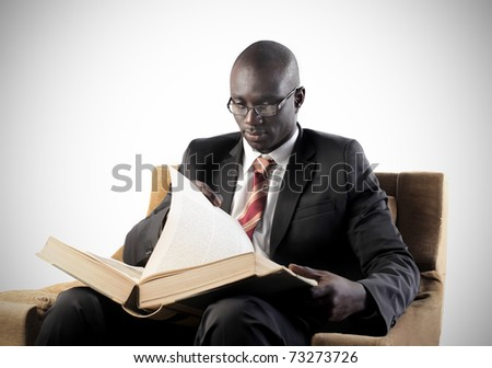 African businessman reading a book - stock photo